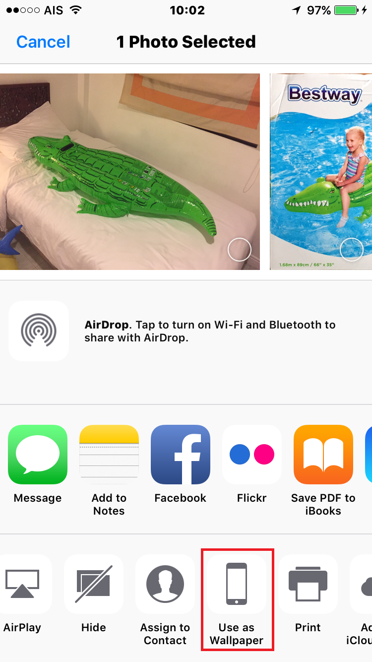 iOS share sheet with a red outline around the 'use as wallpaper' button.